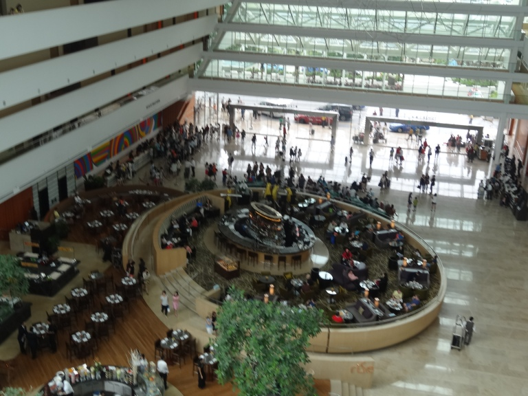 Looking down on Rise Lobby Bar and the Check-in area behind it. It can get very busy.