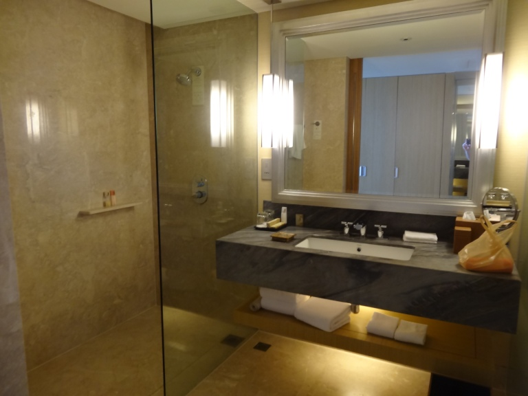 The bathroom has nice vanity areas and separate shower and toilet cubicles