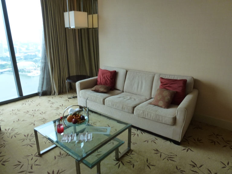 Sofa and glass table in the Premier Rooms