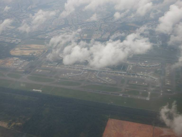 Looking down at Singapore Changi from the clouds
