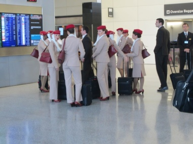 Emirates crew on their way to the gate