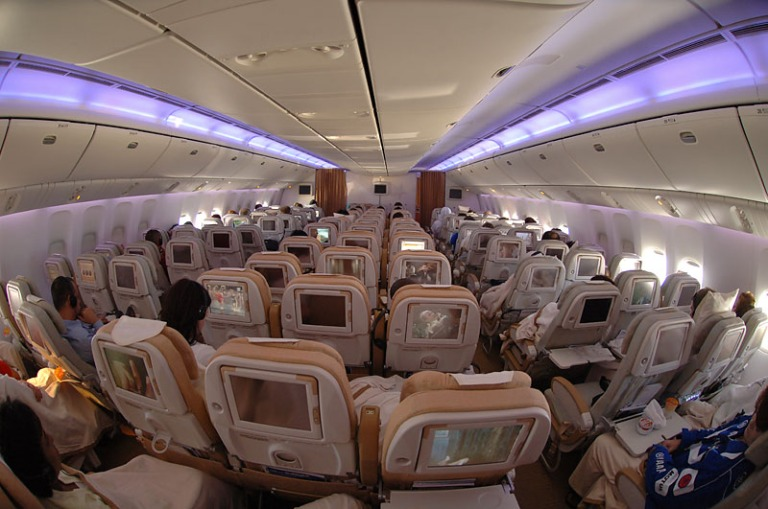 Etihad B777 economy class cabin on a flight from London to Abu Dhabi