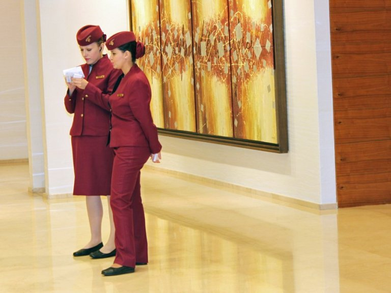 Qatar Airways ground staff outside the Doha Business and First Class Lounge