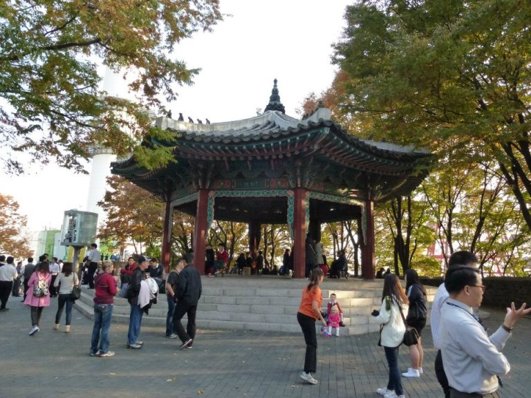 A pagoda at the summit in the shadow of Namsan Tower