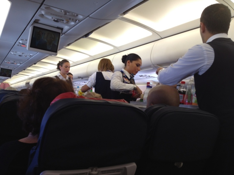 TK crew during meal service on a flight between Kathmandu and Istanbul