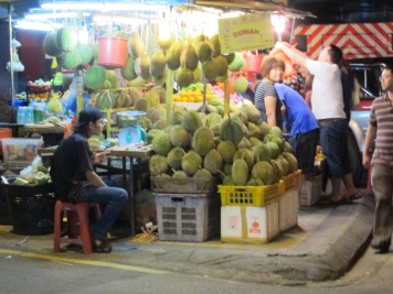 Durians for sale on a street corner of Bukit Bintang at 5am - some things never change...