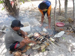 Fish being burned on the beach!