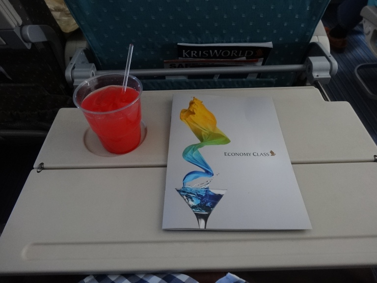 A Singapore Sling with the economy class menu
