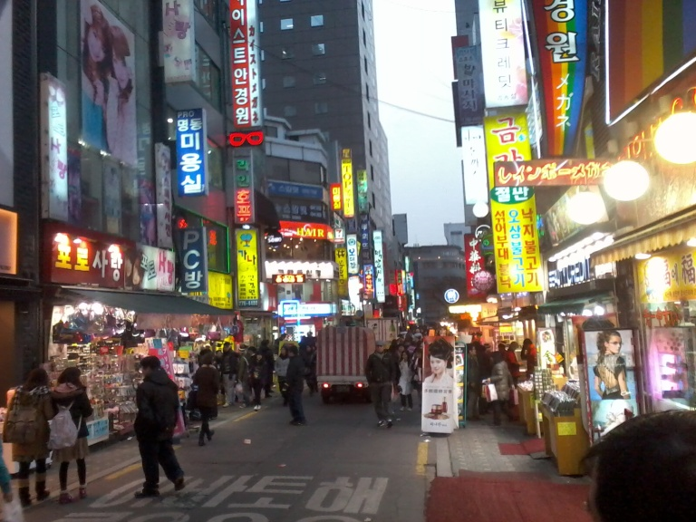 The streets of Myeongdong begin to look a little different as darkness approaches