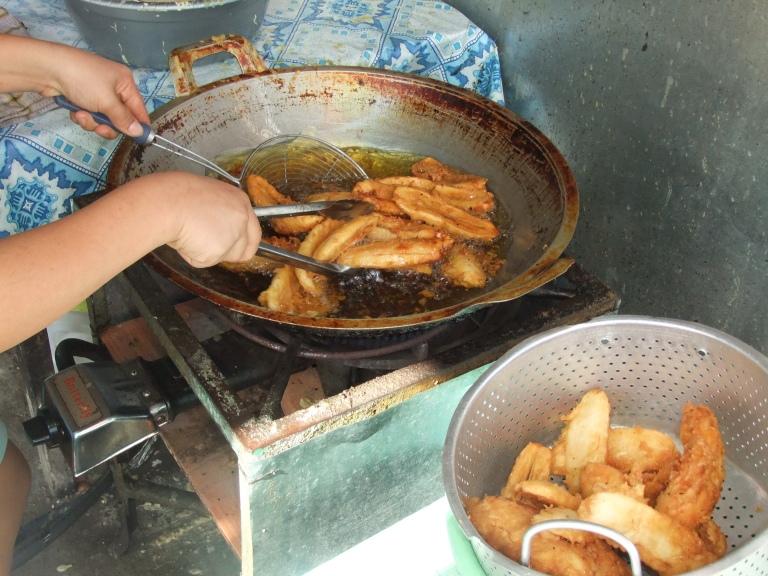 Pisang Goreng being fried in an open wok