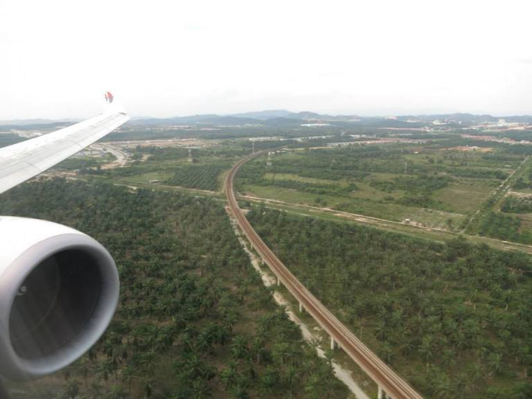 Onboard Malaysia Airlines landing at Kuala Lumpur Airport with the famous palm trees on approach