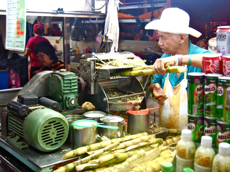 Sugar cane juice being prepared at Gurney Drive, Penang