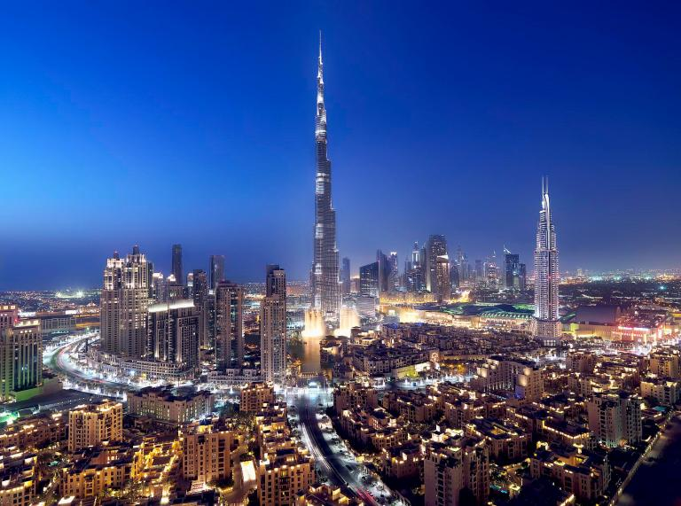 Burj Khalifa, the world's tallest building, shining brightly at twilight