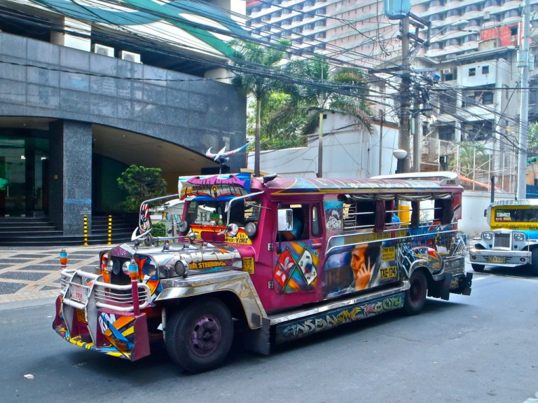 "A colourful bus, and these are called ""jeepneys"""