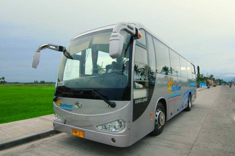 A tourist bus like this will take you from Kalibo Airport to Caticlan jetty