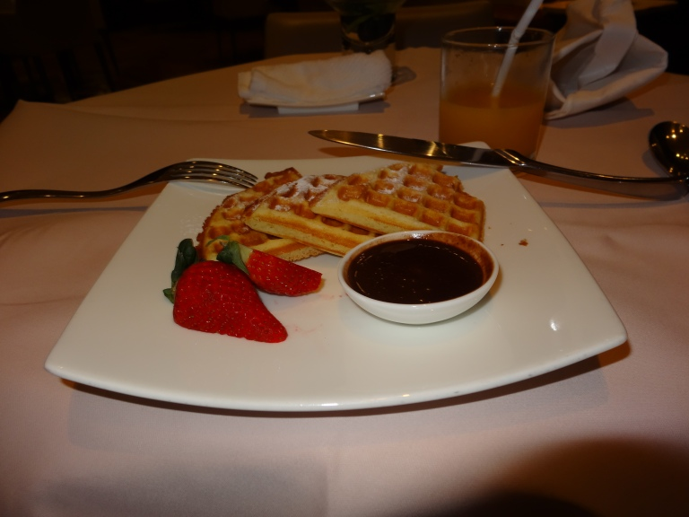 Hot waffles, hot chocolate, and strawberries for breakfast!