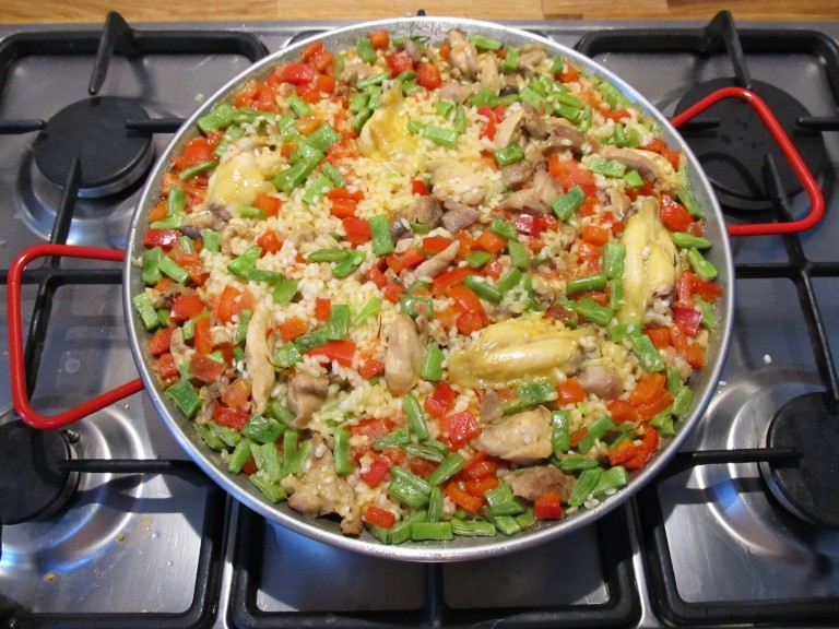 Paella being cooked on the stove