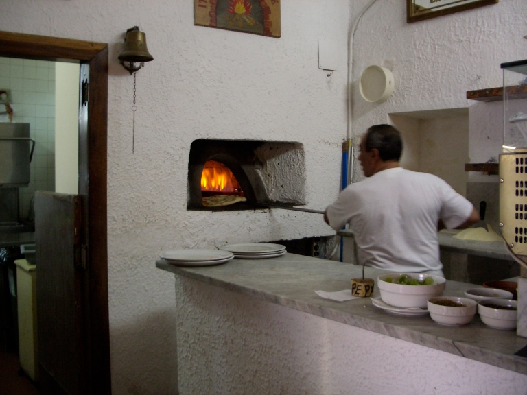 Pizza being put into the oven
