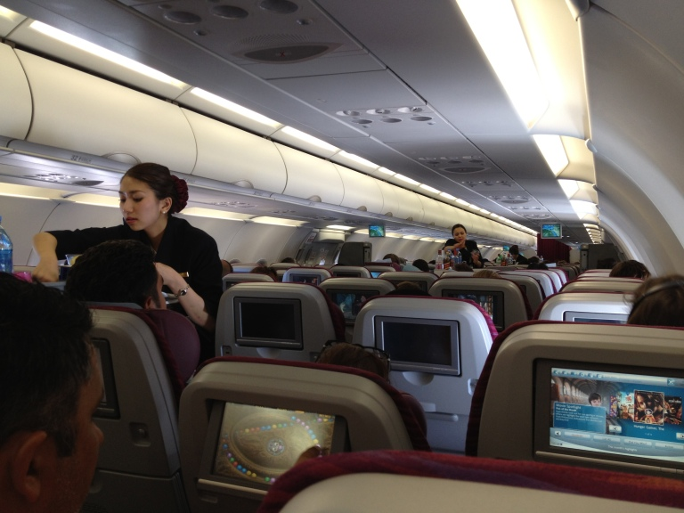 Qatar Airways stewardess hard at work inflight