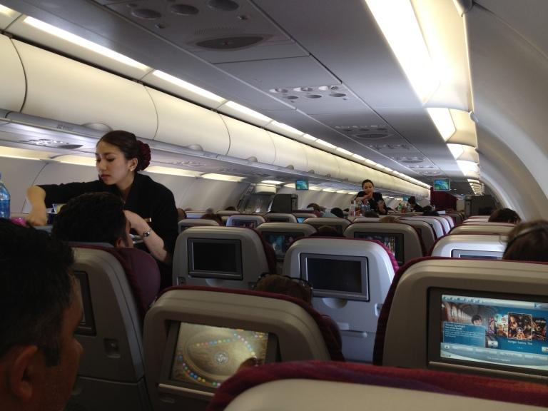 Qatar Airways stewardess hard at work inflight