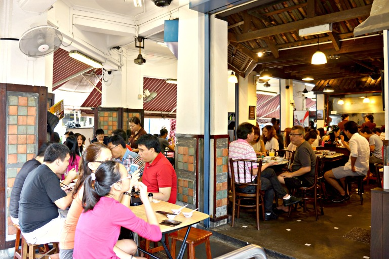 Singaporeans gather with friends and family at home and in public to eat their Bak Kut Teh