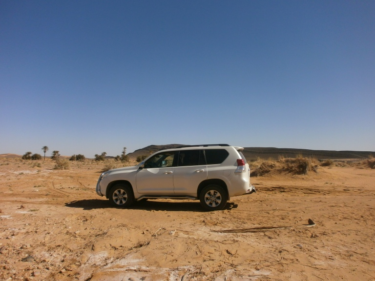 The journey from downtown Marrakech will be in a 4X4 like this one
