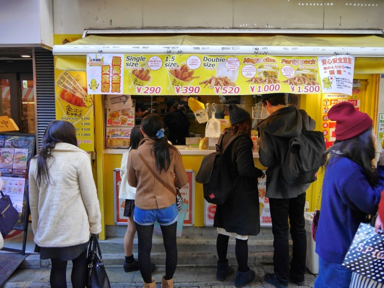 Dinner time in Japan and the queues form near the chicken stall