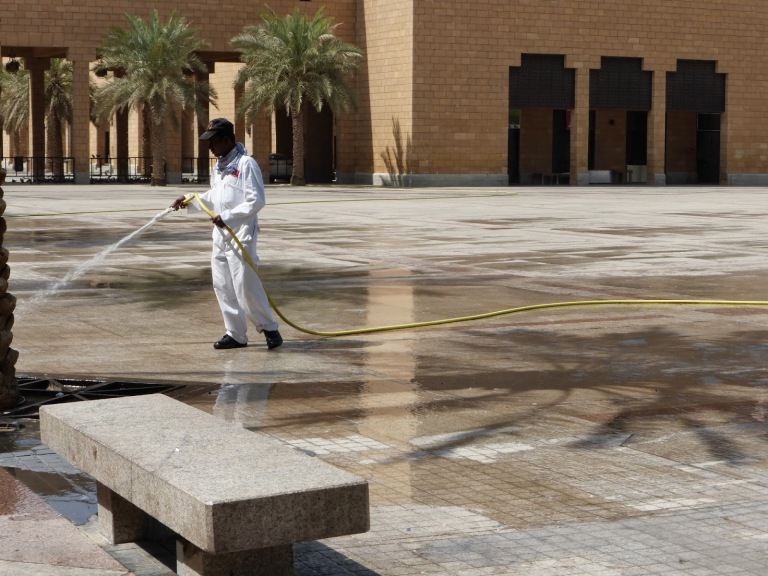 A Saudi worker cleaning up the bloody mess after another public execution in Chop Chop Square