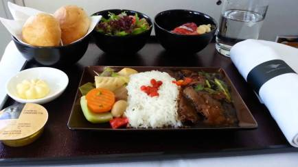Well-presented business class meals with Garuda